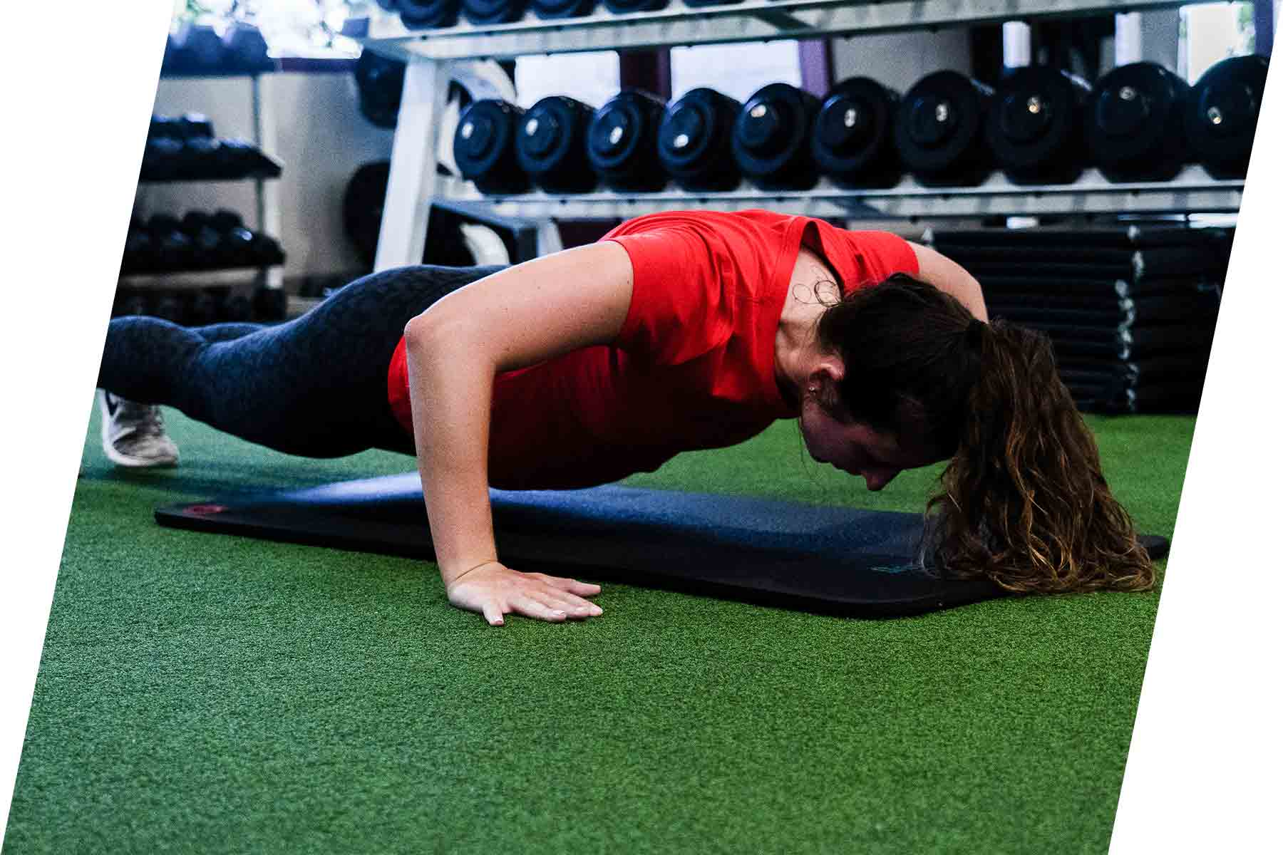 Athlon Elite Fitness young-woman-planking
